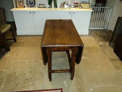 solid oak drop leaf table+ 4 chairs