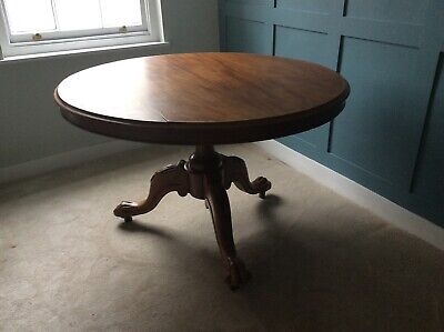 antique,large,tilt top,mahogany?,dining table,tripod base, metal casters