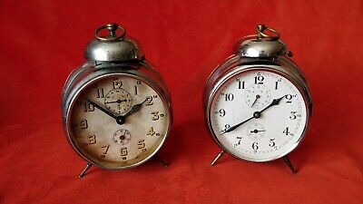 A pair of antique German watches with an alarm clock.Gustav Becker and Junghans.