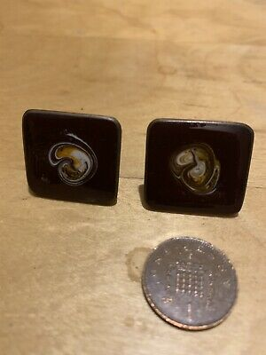 A Pair Of Old Marbled Cufflinks
