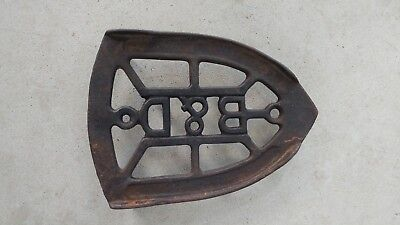 Antique cast iron trivet initials B & D late 1800s for sad irons nice and clean