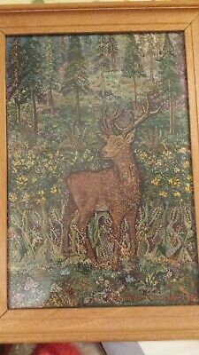 framed signed embroidery of a stag in woodland. 1975.