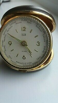 Vintage Elgin Clam shell Travel World Alarm Clock with Bradley time division.