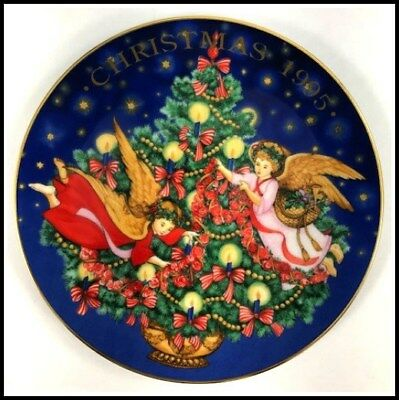 """Avon 1995 Christmas Plate """"Trimming The Tree"""" Porcelain trimmed in 22k gold"""