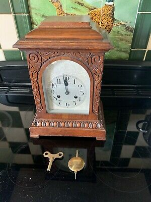 Junghans Oak Mantel Clock - carved decoration-silvered engraved dial-circa1910