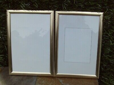 Two gold coloured photograph / picture frames - 33 x 23 cms