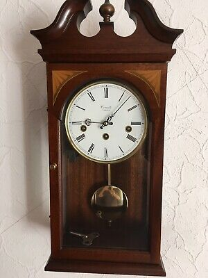 A Westminster Chime Wall Clock By Comitti Of London