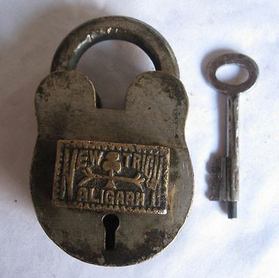 Old or antique Trick puzzle ALIGARH Brass Padlock front button push with key