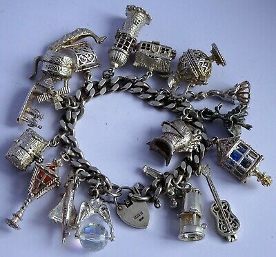 Amazing vintage solid silver charm bracelet & 17 large charms. Rare,open. 124.3g