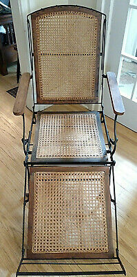 Antique Iron Frame Chaise Cane Seat Lounge possibly made by Cevedra Sheldon