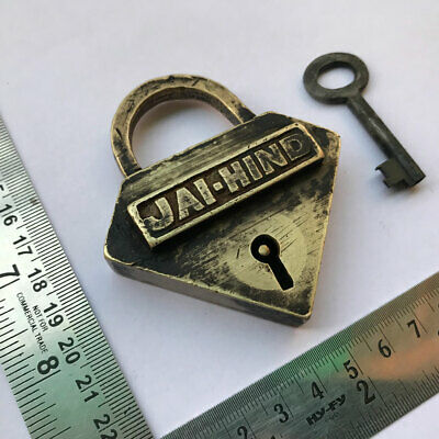 An old solid brass padlock or lock with key triangular shaped JAI HIND