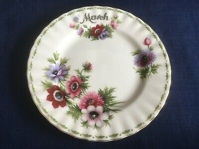 "Royal Albert Flowers Of The Month March  6 1/4""  tea plate ( minor gilt wear )"