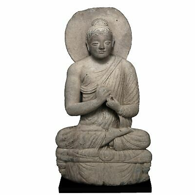 A large Grey Schist Seated Buddha, Gandhara, Peshawar Valley, ca. 3rd century A.