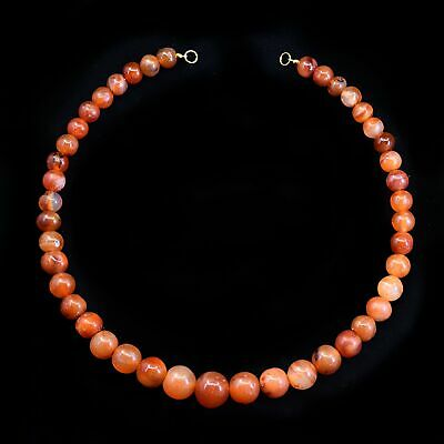 * An Egyptian carnelian ball bead necklace, Middle Kingdom,  c.2025 BC - 1760 BC
