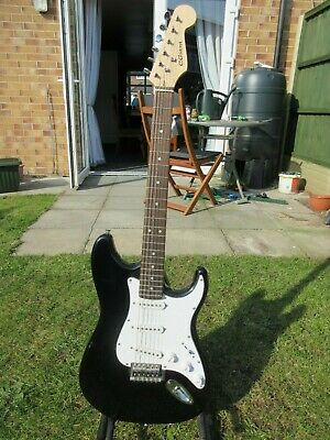 C. Giant electric guitar stratocater shape 6 string