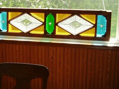 Stained glass in large old window frame