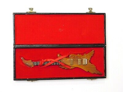 Vintage hand-carved wooden electric guitar with case