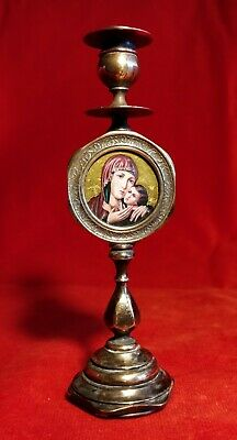 Old bronze candlestick with Russian Orthodox icon Kasperovskaja Mother of God.