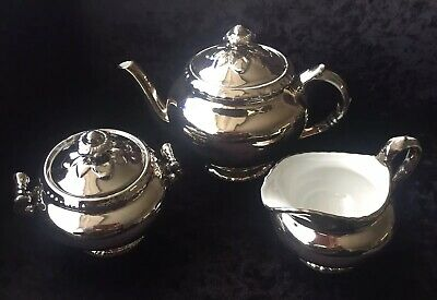 "Royal Worcester ""Fireproof"" Silver Lustre Teapot, Milk Jug & Lidded Sugar Bowl"