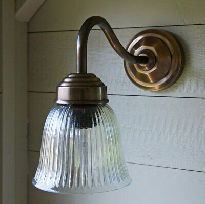 Vintage brass style metal wall light with ribbed glass shade