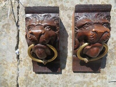 antique french hand carved wood lion's heads with brass rings corbels