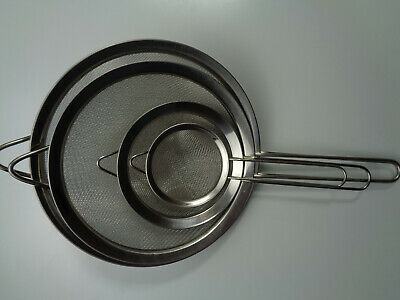 Set of 4 Metal Colanders/Strainers/Sieves each with a Handle And Hook.