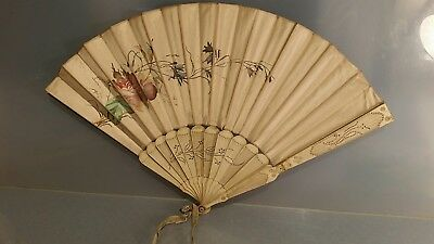 Hand painted floral subjects on fan possibly Victorian carved stays