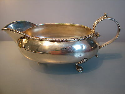 Highly unusual belly  boat shaped sauce boat, gravy boat.