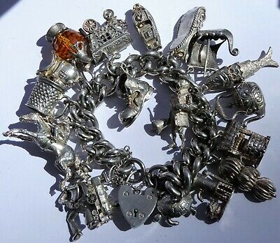 Wonderful vintage solid silver charm bracelet & 18 charms.Rare,open,move. 160.5g