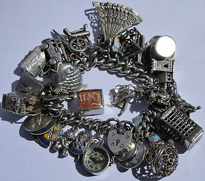 Amazing vintage solid silver charm bracelet & 34 charms.Rare,open,move. 119.4g