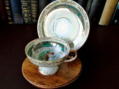 Early 20th c Porcelain Demitasse Cup & Saucer Depicting Lovers With Cupid, Venus
