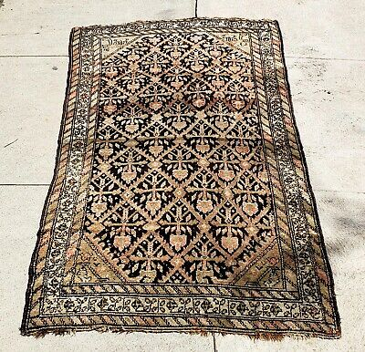 An Antique Rug on Brown Ground