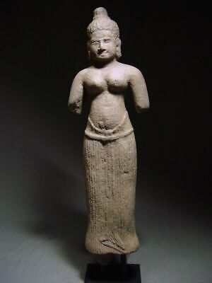 STANDING  FIGURE OF A FEMALE DEITY. STONE. KHMER ANGKOR 'BAPHUON' STYLE. 12th C.