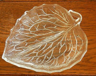 A 2 division moulded glass leaf shaped glass snack / nut dish