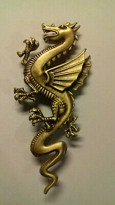 Broche dragon métal doré