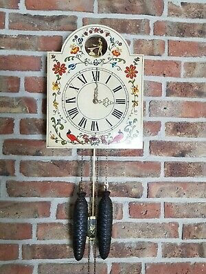 Vintage Schwarzwälder (Black forest) wall clock with moving iron-smith at top