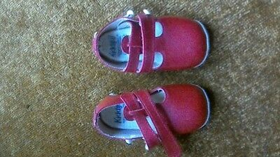 A pair of red vintage KIDDIJOY shoes from the 1960s.