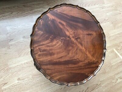 1950's MAHOGANY VENEERED CIRCULAR PIE CRUST EDGED COFFEE / OCCASIONAL TABLE.