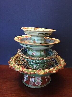 Stack of antique Chinese hand painted multicolored pottery dishes.