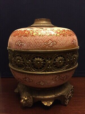 Antique Chinese hand painting porcelain jar sitting on brass stand.