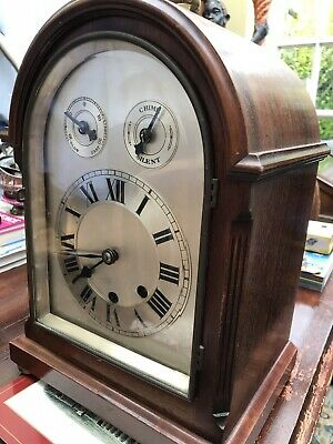 An Edwardian Mahogany Cased Dome Topped Mantle Clock with Silvered Dial
