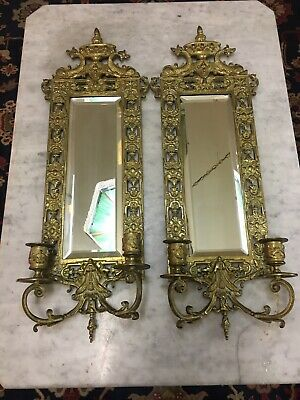 Pair of Antique ornate brass mirrored sconces