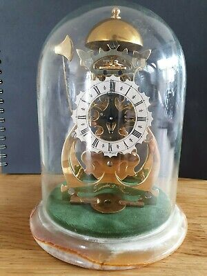 Thwaites and Reed gold plated brass miniature skeketon clock under dome