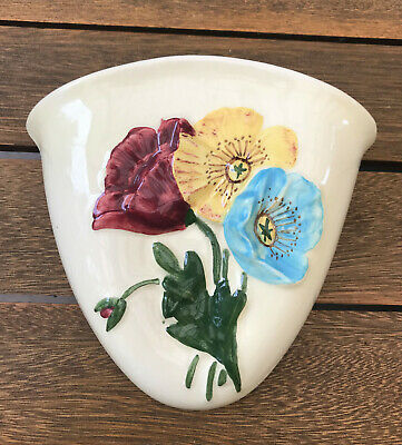 Vintage 1950s Australian pottery wall vase with raised, handpainted flowers