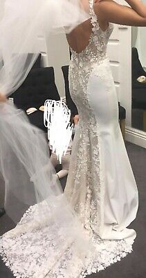 wedding dress size 6-10, 2020 collection, selling for $4,000. Paid $8,000.