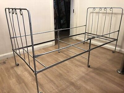 Early 20th century Cast Iron Folding Bed On Wheels