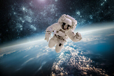 Astronaut in space LAMINATED ART POSTER 24x36in (61x91cm)
