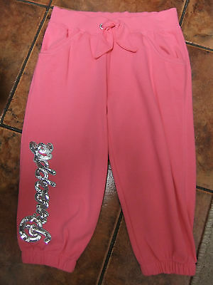 Cropped style trousers in bright hot pink from Debenhams.sequin writing.8-9y