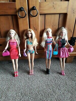 4 stunning barbie dolls shoes clothes bags Very good condition