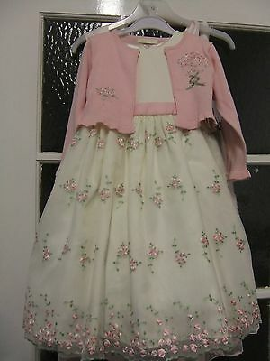 Lovely girls dress with bolero with nice detail.to fit age 3yrs.new